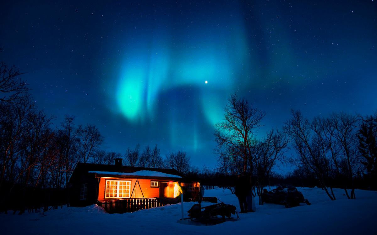 Northern lights over the house in Finland
